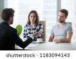 unhappy couple dislike house... | Shutterstock . vector #1183094143