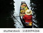 woman trading fruit and food in ... | Shutterstock . vector #1183094266