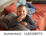 little boy in stripped show... | Shutterstock . vector #1183108573