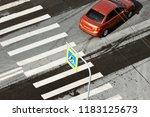 car and zebra pedestrian... | Shutterstock . vector #1183125673