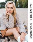 attractive pensive blonde girl... | Shutterstock . vector #1183129699