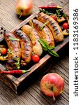 delicious sausages grilled with ... | Shutterstock . vector #1183169386