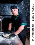 the cook prepares pizza in... | Shutterstock . vector #1183176580