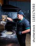 the cook prepares pizza in... | Shutterstock . vector #1183176583