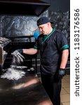 the cook prepares pizza in... | Shutterstock . vector #1183176586