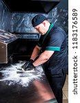 the cook prepares pizza in... | Shutterstock . vector #1183176589