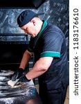 the cook prepares pizza in... | Shutterstock . vector #1183176610