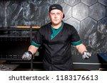 the cook prepares pizza in... | Shutterstock . vector #1183176613