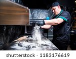 the cook prepares pizza in... | Shutterstock . vector #1183176619