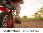 happy boy with his bike.kid... | Shutterstock . vector #1183181263