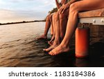 four young friends sitting on... | Shutterstock . vector #1183184386