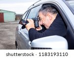 man photographed from the car | Shutterstock . vector #1183193110