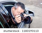 man photographed from the car | Shutterstock . vector #1183193113