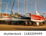 ships are waiting for repairs... | Shutterstock . vector #1183209499