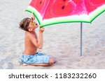 a boy in sun glasses on the sea ... | Shutterstock . vector #1183232260