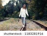 happy girl with film camera... | Shutterstock . vector #1183281916