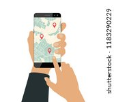 hand holds a smartphone. using... | Shutterstock .eps vector #1183290229