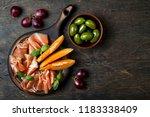 jamon serrano or prosciutto... | Shutterstock . vector #1183338409