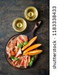 jamon serrano or prosciutto... | Shutterstock . vector #1183338433