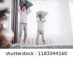 kids playing in parents bed.... | Shutterstock . vector #1183344160