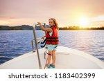 kids sail on yacht in sea.... | Shutterstock . vector #1183402399