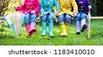group of kids in rain boots....   Shutterstock . vector #1183410010