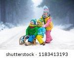 little girl and boy enjoying... | Shutterstock . vector #1183413193