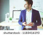 young designer writing sms in... | Shutterstock . vector #1183416193