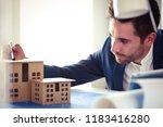 businessman holding house... | Shutterstock . vector #1183416280