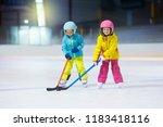children play ice hockey on...   Shutterstock . vector #1183418116