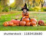 children in black and orange...   Shutterstock . vector #1183418680