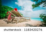 christmas on beach  chair... | Shutterstock . vector #1183420276