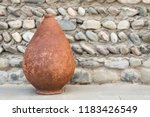 old kvevri on stone background  ... | Shutterstock . vector #1183426549