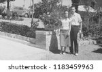 portrait of young couple in 1950 | Shutterstock . vector #1183459963