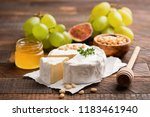 brie or camembert cheese with... | Shutterstock . vector #1183461940