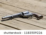 detail on a revolver or pistol... | Shutterstock . vector #1183509226