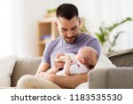 family  parenthood and people... | Shutterstock . vector #1183535530
