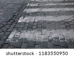 partial view of grey cobble... | Shutterstock . vector #1183550950