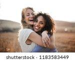 two female friends having fun... | Shutterstock . vector #1183583449