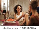 friends having drinks in a... | Shutterstock . vector #1183586026