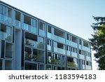 facade of new modern apartment... | Shutterstock . vector #1183594183