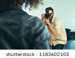 photographer shooting... | Shutterstock . vector #1183602103