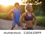 stretching before work out .... | Shutterstock . vector #1183610899