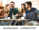 group of four friends having a... | Shutterstock . vector #1183623769