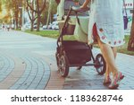 mother with a stroller on a walk | Shutterstock . vector #1183628746