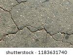 cracked asphalt road texture   Shutterstock . vector #1183631740