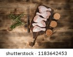 raw chicken legs and marinade... | Shutterstock . vector #1183642453