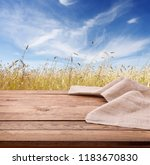 empty wooden deck table with... | Shutterstock . vector #1183670830
