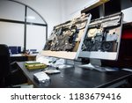 open disassembled computers on... | Shutterstock . vector #1183679416
