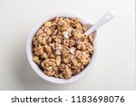 bowl of homemade granola with... | Shutterstock . vector #1183698076